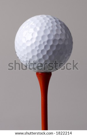 Golf ball(s) on tee in studio. Isolated from background colors. - stock photo