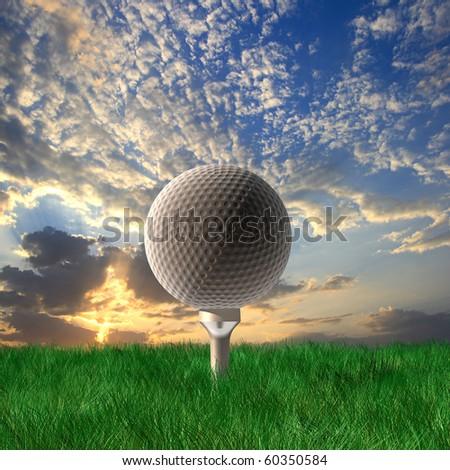 Golf ball under cloudy sky - stock photo