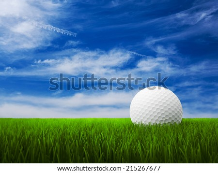 Golf Ball with grass and blue sky - stock photo