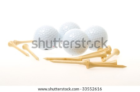 golf balls with tees isolated on white - stock photo