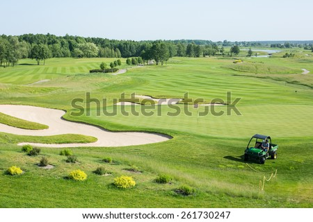 Golf car in golf course - stock photo