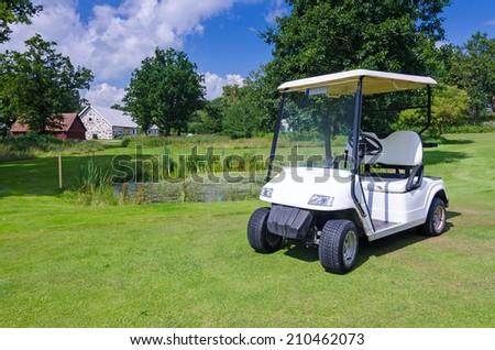 Golf car on Swedish golf course - stock photo