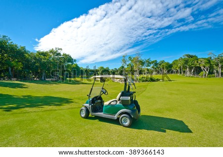 Golf cart at the beautiful caribbean, tropical golf course. - stock photo