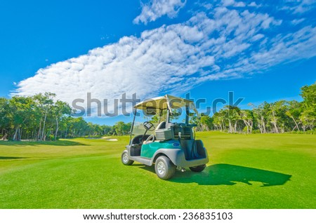 Golf cart at the beautiful golf course at the luxury caribbean, mexican resort. - stock photo