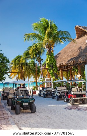 Golf carts in a raw outside, nobody. Mexico, Cancun, Isla Mujeres - stock photo