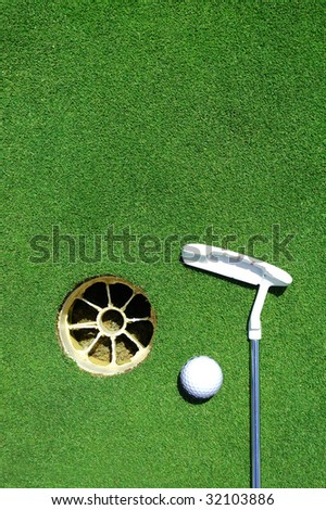 Golf club, hole, white ball on green grass with room for copy space - stock photo