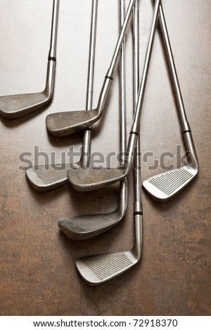 golf club on wooden background - stock photo