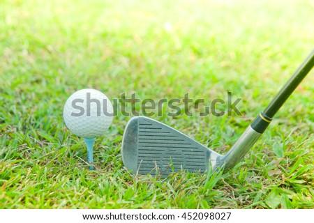golf club with ball on tee - stock photo