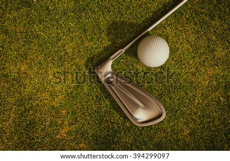 Golf clubs and golf balls on the grass 3d rendering. - stock photo