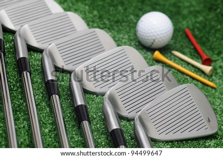 golf clubs, ball and tees - stock photo