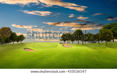 Golf course at sunset with a green. - stock photo
