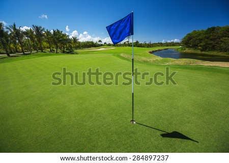 Golf course. Beautiful landscape of a golf court with palm trees in Punta Cana, Dominican Republic - stock photo