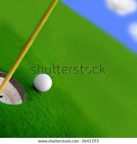 Golf course green and ball closeup - stock photo