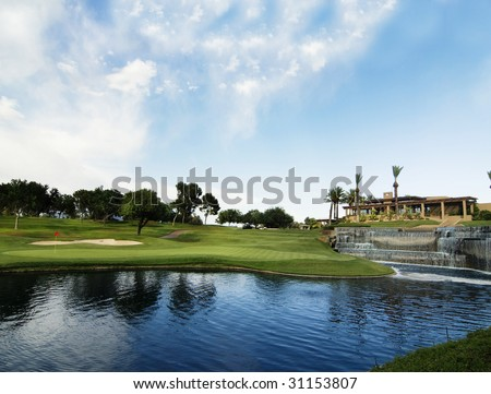 Golf course green and clubhouse in Ariona - stock photo