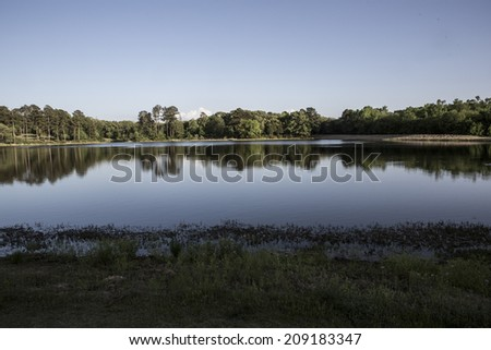 Golf Course Lake near in Chandler, TX. April 23, 2014 - stock photo
