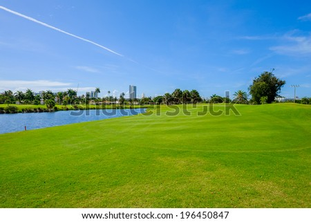 Golf course landscape viewed from the fairway. - stock photo