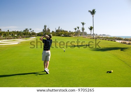 Golf course resort scenes of players and holes - stock photo