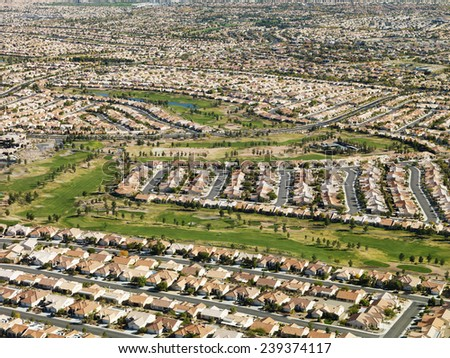 Golf Course Surrounded by Housing Developments - stock photo