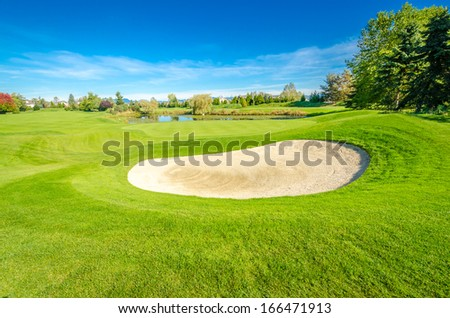 Golf course with gorgeous green and fantastic mountain view - stock photo