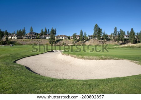 Golf course with residential houses - living in Okanagan - stock photo