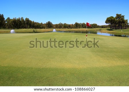 Golf course with water hazard. - stock photo