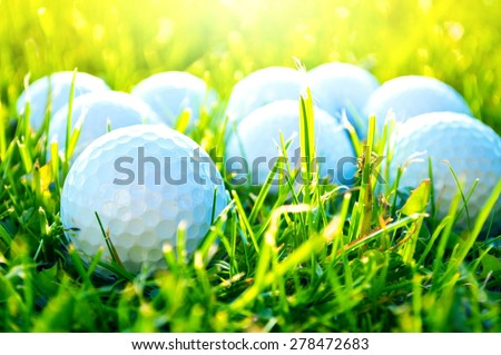 Golf game. Golf balls in grass. - stock photo