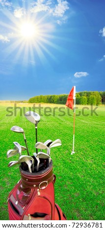 Golf game. Golf clubs in bag against the golf course with bright sun. - stock photo