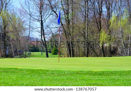 Golf green spring time. - stock photo