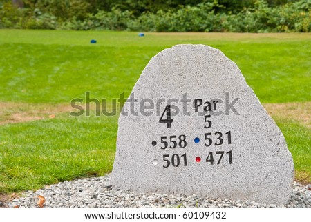 Golf hole sign and teeing area. - stock photo