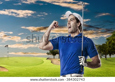 Golf Player in a blue shirt celebrating, on a golf course. - stock photo