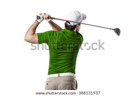 Golf Player in a green shirt taking a swing, on a white Background. - stock photo