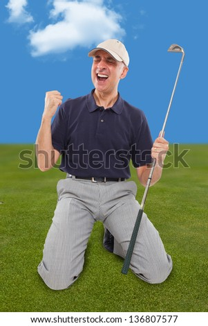 Golf player on knees with club in hand on golf green - stock photo