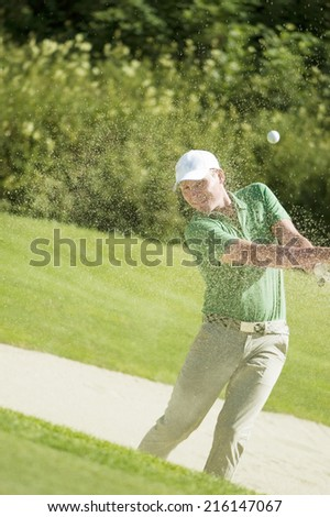 Golf player playing bunker shots - stock photo