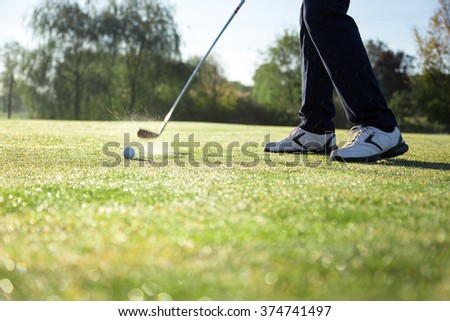 Golf player tests golf swing on the fairway. - stock photo