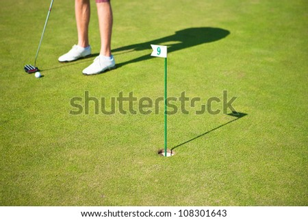 Golf player training a par before actual golf game - stock photo