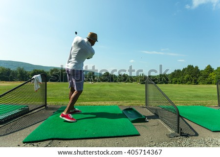 Golf Practice at the Driving Range - stock photo
