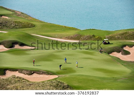 golf resort with the scenery of the sea. summer vacation - stock photo