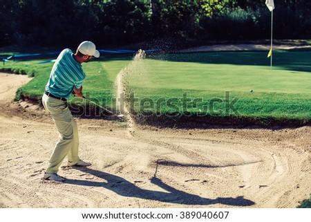 Golf. Sand trap play - stock photo