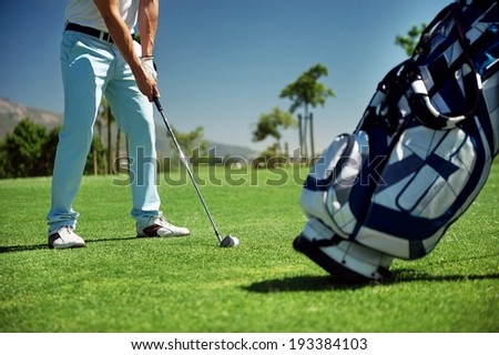Golf shot on course in fairway on vacation - stock photo