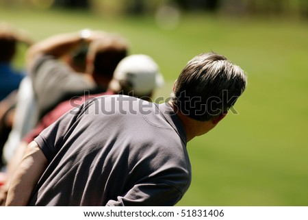 Golf spectator waits for the ball - stock photo