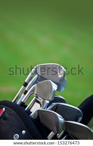 Golf sticks on grass/golf sticks vertical composition - stock photo