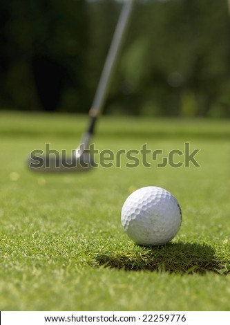 golfball and putter - stock photo