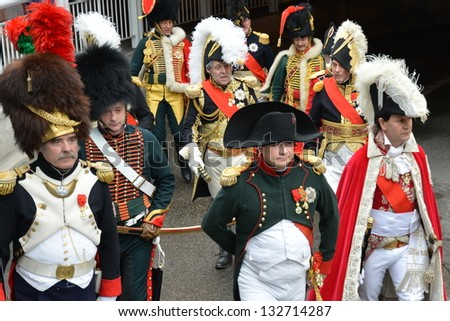 GOLFE JUAN, FRANCE-MARCH 23: ceremony of Napoleon landing shown in march 23,2013 on Golfe Juan, French Riviera. On march 1815 Napoleon returns from Elbe island to reconquer the power in France. - stock photo