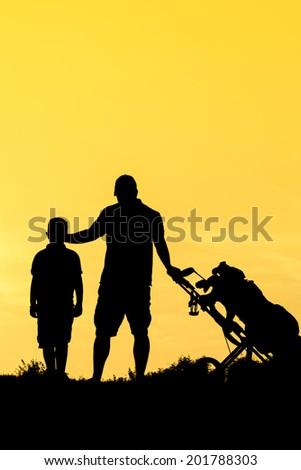 Golfer at sunset - stock photo