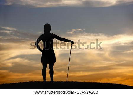 Golfer at sunset looks at view. - stock photo