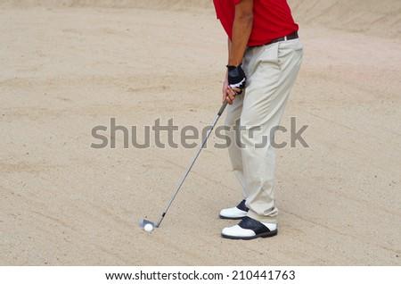 Golfer driver ball from sand bunker - stock photo