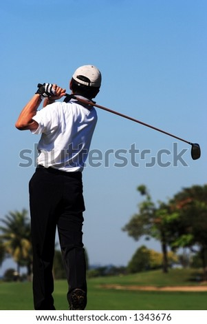 Golfer in action - stock photo