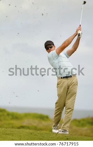 Golfer in action from the fairway - stock photo