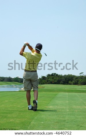 Golfer in the after swing - stock photo