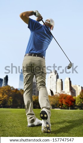 Golfer in the city - stock photo